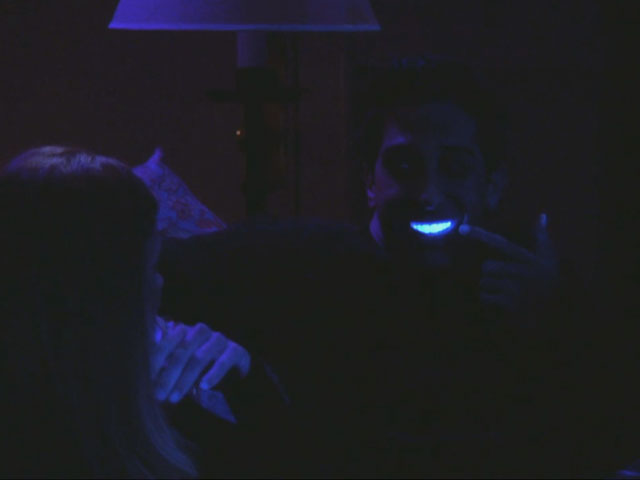 Friends | 608 | Ross' teeth under the black light